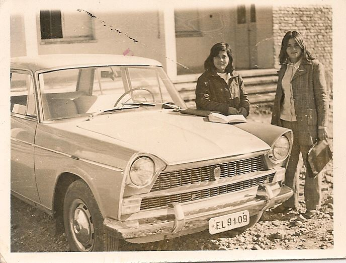 Photo credit courtesy of Shannon Woodcock. The woman leaning against the car is interviewee Lili Majko in 1973, in front of Elbasan University.